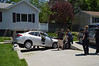 05/17/2014 12:30 hrs. Medford MVA Gull Ave-Lambui : Car lands in driveway in Medford Saturday, May 17, 2014.  The Medford F.D., E.M.S., and officers from SCPD's 6th Pct. and E.S.U. responded at approx. 12:30 p.m. when the elderly man driving this 2008 Hyundai Elantra apparently lost control while traveling southbound on Gull Avenue, just south of Knickerbocker Avenue. The Elantra traveled across the lawn of 2717 Gull Avenue and ended up being wedged and partially suspended sideways over the sloped driveway of the residence. First responder's were able to remove the driver, his female passenger, and their dog from the vehicle where the couple were then transported by ambulance to a local hospital. The driver and his passenger's injuries ranged from moderate to serious.