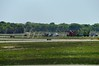 """05/20/2014 10:30 hrs. MacArthur Airport Plane crash-Lambui : Damaged plane on runway at MacArthur Airport Monday, May 20, 2014. The pilot of a small plane radioed in to the tower that their landing gear would not go down and that they needed to make an emergency """"gear-up"""" landing at MacArthur Airport at approx. 10:30 a.m. No injuries were reported."""