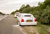 Limo loses suspension on LIE (Rt. 495) in Yaphank Saturday, July 26, 2014. A limo traveling west bound at approx. 16:00 hrs. on the LIE lost it's rear suspension resulting in the rear tire rubbing against it's body causing a small fire which was extinguished by the driver with a dry chem. extinguisher. The bevy of beauty's the limo was carrying were able to exit the limo and no injuries were reported. There were no worries, as the women had enough champagne to last them until another mode of transportation arrived. The Yaphank F.D. and Suffolk County Highway patrol responded to the scene. One of the women, and I won't mention who, seemed to be having a spate of bad luck this day, as I saw her later on, east bound this time, with another broken down vehicle, which I assume is the one that rescued her the first time, that appeared to have a flat tire.