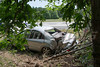 "Car accident sends vehicle into woods in Ridge Monday, July 28, 2014. A two car accident occurred at approx. 1:15 p.m. on the west bound LIE (Rt. 495) just east of exit 68 (William Floyd Pkwy.), sending this Lincoln Mercury into the woods injuring the driver. The SCPD Hwy. Patrol and Ridge F.D. responded to the scene at the exit ramp to William Floyd Pkwy. The woman driving the Lincoln was transported to Brookhaven Memorial Hosp. with undisclosed injuries. The driver of the Jeep Cherokee refused medical aid saying she was ""just shaken up""."