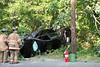 07/30/2014 16:35 hrs. Manorville MVA-Lambui : Car hits pole and flips into woods in Manorville Wednesday, July 30, 2014.  Two people were injured when the operator of this four-door sedan lost control, struck a telephone pole and flipped into the woods, while traveling north on Wading River Road near Cedar Lane at approx. 4:35 p.m. The driver and passenger were transported by ambulance to Brookhaven Memorial Hosp. in Patchogue.