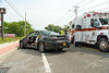 "Two car accident in Mastic Saturday, August 16, 2014. The driver of this Pontiac Grand Prix was injured, and transported to a local hospital by ambulance, after being cut out of her car by Mastic firefighters, using the ""Jaws of Life"", when she collided with another vehicle on Montauk Hwy. and Roberts Street in Mastic at just after 10:30 a.m. Saturday morning. Two children who were also in the Pontiac received minor injuries."