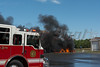 """09/08/2014 10:00 hrs. Ridge pick-up truck fire-Lambui : Pick-up truck fire in Ridge Monday, September 8, 2014.  At approx. 10:00 a.m. the Ridge F.D. and SCPD 7th Pct. responded to the Long Island Shooting Range of Brookhaven located in Fireman's park for a reported truck fire. Upon arrival, firefighters were confronted with a fully involved fire in a pick-up truck, which also contained ammunition for the firearms range, that was extending to a structure.  Also hindering operations was the fire's close proximity to propane cylinders. As ammunition was heard popping, due to the fire's intensity, firefighters had to maintain a safe distance and use their """"deck guns"""" mounted atop their fire apparatus to safely reach the blaze. After the main body of fire was extinguished, and over 2000 feet of 5"""" hose was stretched, firefighters advanced with fire hoses to extinguish the rest of the truck fire and to examine the building which was damaged in the inferno. The Middle Island F.D. was also called in to assist with the fire."""