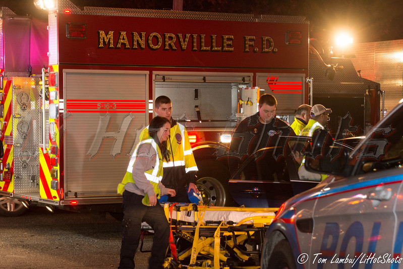 Two car accident in Manorville Saturday, December 13, 2014. The driver of a 2009 Honda Accord, traveling west bound on Moriches Middle Island Rd., attempted to turn left on to North Titmus Ave. and collided with a 2006 Honda Accord traveling east bound on Moriches Middle Island Rd. at approx. 20:45 hrs. Under the command of M.F.D. Lieutenant Seth Cozzell (05-16-30) M.F.D. members secured the vehicles and the driver of the E/B '06 Honda was taken to the hospital by Manorville Community Ambulance.