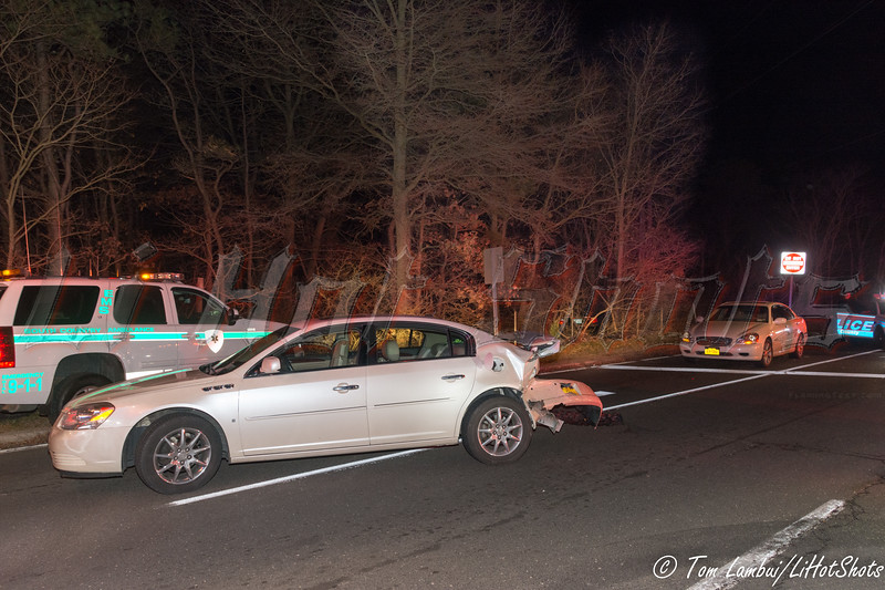 Three car accident in East Patchogue Thursday, December 18, 2014. A three car collision at the intersection of Sills Road and the South Sunrise Service Road sent a BMW into the woods and injured at least five people. An Infiniti and a Buick were also involved in the wreck that occurred at approx. 7:15 p.m. The Hagerman F.D., SCPD 5th Pct., and numerous ambulances from South Country Ambulance responded to the scene. Northbound Sills Rd. (CR-101) was closed at North Dunton Ave. while the accident scene was being secured. There was no disclosure as to the type or severity of the injuries to the numerous victims.