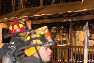 Vacant house burns in Mastic Friday, December 26, 2014. The Mastic Fire Dept. responded to this house fire at 151 Clinton Ave. at approx.. 1:40 a.m. Firefighters encountered a heavy fire condition upon their arrival and had the blaze under control in just under thirty minutes. The Brookhaven F.D. and Mastic Beach F.D.'s also responded as well as the SCPD 7th Pct., and SCPD arson investigators. The house was completely gutted.