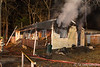 12/26/2014 01:40 hrs. Mastic Fire-Lambui : Vacant house burns in Mastic Friday, December 26, 2014. The Mastic Fire Dept. responded to this house fire at 151 Clinton Ave. at approx.. 1:40 a.m. Firefighters encountered a heavy fire condition upon their arrival and had the blaze under control in just under thirty minutes. The Brookhaven F.D. and Mastic Beach F.D.'s also responded as well as the SCPD 7th Pct., and SCPD arson investigators. The house was completely gutted.