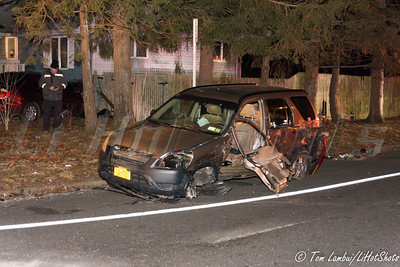 "Car strikes house in Shirley Wednesday, December 31, 2014. At approx. 6:00 p.m. authorities responded to reports of a two car accident at the intersection of Victory Ave. and Auburn Ave. and upon arrival, officers from the SCPD 7th Pct. and members of the Brookhaven F. D. found a two car accident where one of the cars, a Toyota Camry, had also crashed into a residence on Auburn Ave. and found the Toyota's two occupants lying on the ground. The occupant of the other vehicle, a four-door Honda SUV, was pinned in her vehicle and had to be cut out of her car by officers from SCPD's elite Emergency Services Unit using their hydraulic ""Jaws of Life"" Hurst Tools. All three injured were taken to a local hospital with undisclosed injuries."