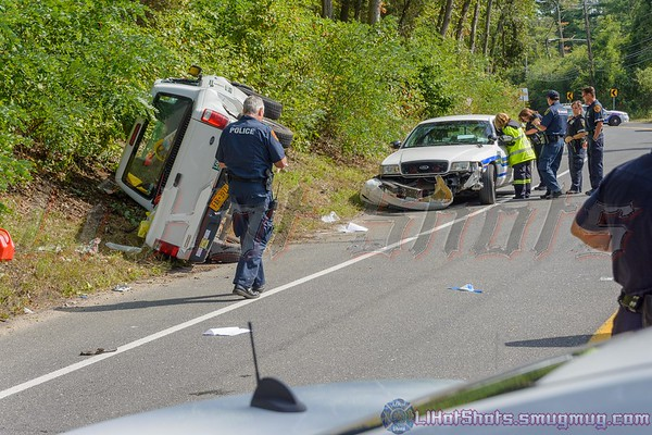 Accident in Yaphank Sunday September 13, 2015. At approx. 14:00hrs. a collision occurred on Yaphank Middle Island Road (C.R. 21), near Cathedral Pines County Park, between a Suffolk County Parks Ranger police vehicle and a Ford Ranger pickup truck. The pickup driver was trapped in his vehicle and had to be extricated by the SCPD Emergency Service Unit officers along with the assistance of the Yaphank Fire Dept. The injured pickup driver was transported by Yaphank F.D. ambulance to Brookhaven Memorial Hospital. The Parks Rangers injuries were unknown at this time. Yaphank Middle Island Road was closed in both directions for a crime scene investigation.