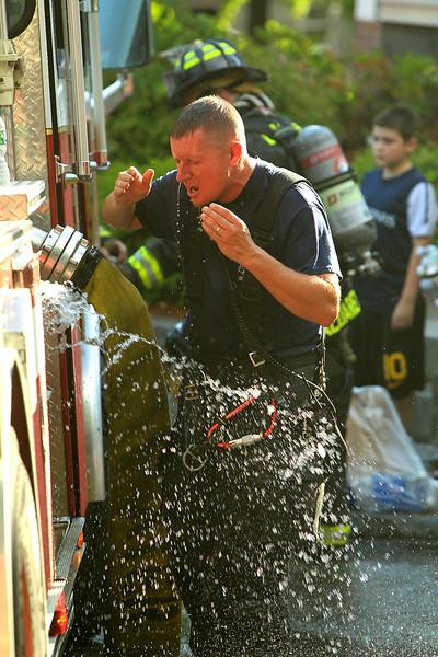 Lt. Timothy Shea cools off <br /> <br /> Photo Scott LaPrade