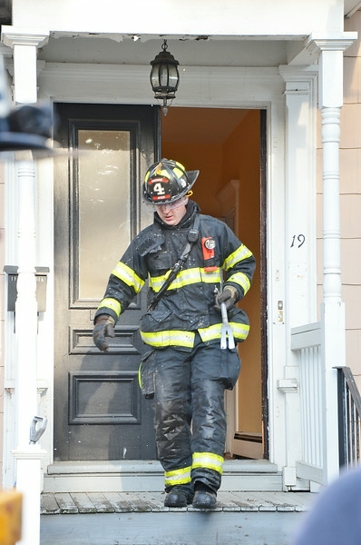 A fire broke out Thursday evening at 19 Columbia Street in Ayer after lightning struck the home. The fire was extinguished quickly. SENTINEL & ENTERPRISE / Ashley Green