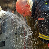 A firefighter attempts to cool off during this humid heat<br /> <br /> Photo Scott LaPrade