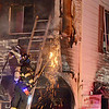 Leominster and Fitchburg Fire Departments work on the scene of a fire at 381 Summer Street in Fitchburg around 9:30 Tuesday evening. The build is the home of O.G Croteau's Plumbing and Heating. SENTINEL & ENTERPRISE / Ashley Green