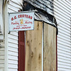 Boarded up windows the day after a fire tore through the building at 381 Summer Street in Fitchburg. The building is the home of O.G Croteau's Plumbing and Heating. SENTINEL & ENTERPRISE / Ashley Green