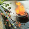 Lt Gary Dunner of Leominster Fire holds on the boat with a hook so it dosent float away.<br /> <br /> Photo Scott LaPrade