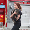 A fire broke out at 71-73 Boutelle Street on Monday afternoon. Sarah walks away with her cat Jax after a firefighters handed him to her while firefighters were still fighting the fire. SENTINEL & ENTERPRISE/JOHN LOVE