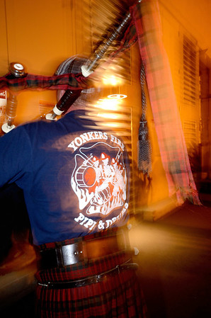 A piper from the Yokers, NY FD prepares to march through the streets of Colorado Springs the night prior to the 2013 IAFF Fallen FF Memorial