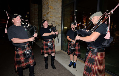 Pipers from the Unified Fire District (Salt Lake CIty, UT) prepare to march through the streets of Colorado Springs the night prior to the 2013 IAFF Fallen FF Memorial