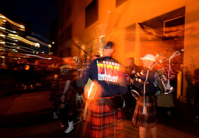Pipers prepare to march through the streets of Colorado Springs the night prior to the 2013 IAFF Fallen FF Memorial