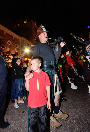 A piper from the Aurora, CO FD plays in the streets of downtown Colorado Springs the night before the 2013 IAFF Fallen FF Memorial.