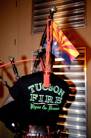 A piper from the Tuscon FD prepares to march through the streets of Colorado Springs the night prior to the 2013 IAFF Fallen FF Memorial