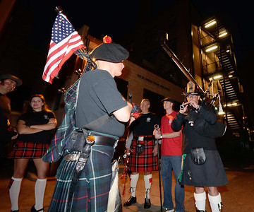 Massed pipe band warms up prior to marching through the streets of downtown Colorado Springs before the 2013 IAFF Fallen FF Memorial