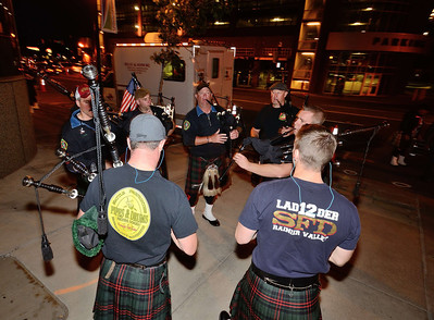 Pipers from  the Seattle, WA FD prepare to march through the streets of Colorado Springs the night prior to the 2013 IAFF Fallen FF Memorial