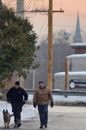 A Mass State Police K9 officer and Fitchburg PD detective search the area around 276 Kimball St, Fitchburg about 8 a.m. Dec 21st 2013in the search for the missing 5 year old from that address