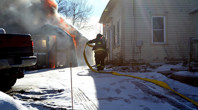 Gardner FFs operate at a 2nd Alm garage fire at  165 High St. on Dec 30 2013. Hubbardston and Westminster FFs assisted Mutual Aid