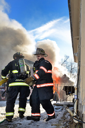 Gardner FFs call for the 1st line to be charged as they operate at a 2nd Alm garage fire at 16f High St on Dec 30 2013. FFs from Westminster and Hubbardston assisted at the scene.