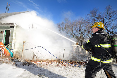 Gardner Lt Greg Lagoy operates at a 2nd Alm garage fire at 165 High St on Dec 30 2013. FFs from Hubbardston and Westminster also assisted at the scene.