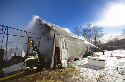 Gardner and Westminster FFs operate at a 2nd Alm garage fire at 165 High St on Dec 30 2013. FFs from Hubbardston assisted at the scene.