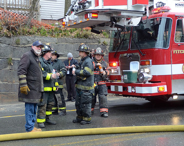 Fitchburg FFs, assisted by Leominster  FFs take a break after knocking down a 2nd Alm fire on Westminster St Over 25 people were displaced. Two dogs were rescued from an apartment.