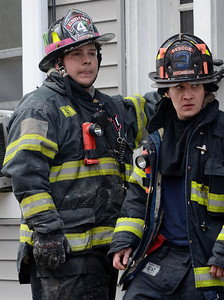 Fitchburg FFs Sean Roy (L) and Donnie Fenwick exit the building at a 2nd Alm fire on Westminster St Over 25 people were displaced. Two dogs were rescued from an apartment.