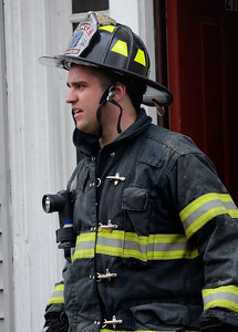 Fitchburg FF Shane Thomas exits the building at a 2nd Alm fire on Westminster St Over 25 people were displaced. Two dogs were rescued from an apartment.