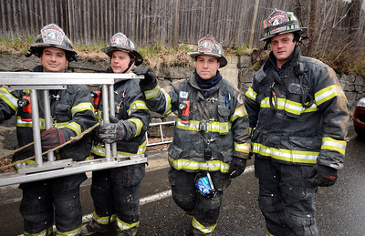 The Roys +1.Fitchburg FFs (l-r) Andy, Sean, and PJ Roy, along with Anthony Knowles put away a 35' ladder at a 2nd Alm fire on Westminster St Over 25 people were displaced. Two dogs were rescued from an apartment.