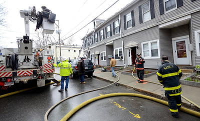 Unitil workers prepare to cut power to the building during a 2nd Alm fire on Westminster St in Fitchburg. Over 25 people were displaced. Two dogs were rescued from an apartment.