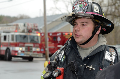 Fitchburg FF Sean Roy takes a breaqk after a 2nd Alm fire on Westminster St Over 25 people were displaced. Two dogs were rescued from an apartment.