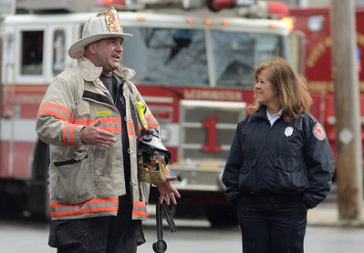Leominster Deputy Chief Dan Kirouac talks with Fitchburg Fire Lieut Sally Tata, head of the city's Fire Prevention Bureau at a 2nd Alm fire on Westminster St in Fitchburg. Over 25 people were displaced. Two dogs were rescued from an apartment.