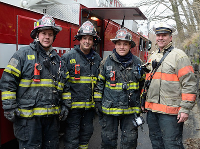 Fitchburg FFs (l-r) Sean, Andy, PJ and Chief Kevin Roy at a 2nd Alm fire on Westminster St Over 25 people were displaced. Two dogs were rescued from an apartment.