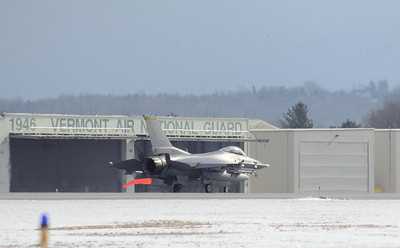 Fenway 21, Vermont Air Natl Guard F16 lands at Burlington (Vt) Airport after declaring an in flight emergency. Spots in top of frame are birds.