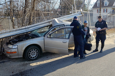 Fitchburg EMS and PD tend to the driver of a car that crashed through a guardrail on Pratt Rd across from Parkhill Park. The driver was txp with minor injuries