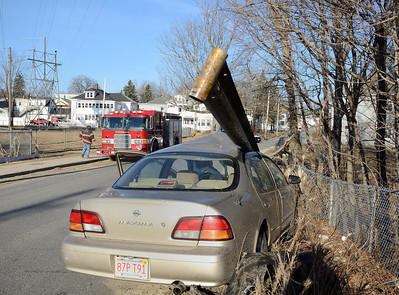 A car crashed through a guardrail on Pratt Rd across from Parkhill Park with only minor injuries to the driver.
