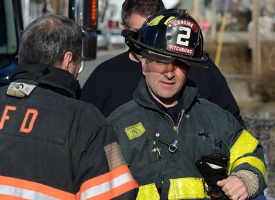 Fitchburg FF Jim Nault stands by at an MVA on Pratt Rd.