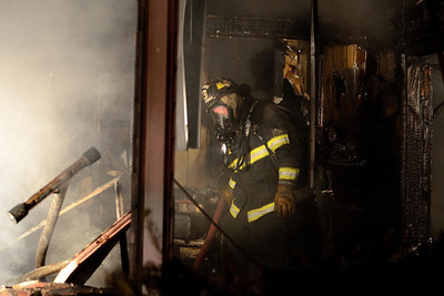 Gardner FF Eric Hulette operates inside at a 2nd Alm fire in an occuppied dwelling on Coburn St Extension
