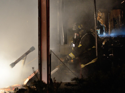 Gardner FF Eric Hulette operates at a 2nd Alm fire in an occuppied dwelling on Coburn St Extension