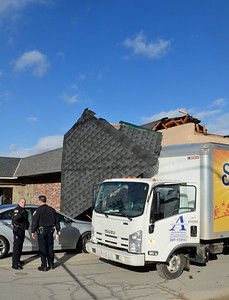 Gardner Fire and Police investigate a box truck that took down a part of the roof at WIlliam's Restaraunt, Pearson Blvd Friday afternoon. There were no injuries.