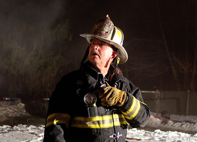 Gardner FD Captain Dick Ares directs crews at a 2nd Alm fire in an occuppied dwelling on Coburn St Extension