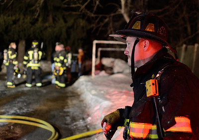 Gardner FF Craig Osowski stands by at a 2nd Alm fire in an occuppied dwelling on Coburn St Extension