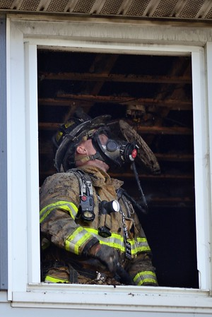 A Holden firefighter overhauls after a fatal fire at 18 Farragut Way. Mutual Aid was called from Rutland, Paxton and Sterling. Investigators from the State Fire Marshals office were called to investigate